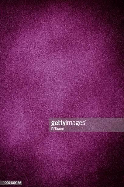 dark texture background with bright center spotlight