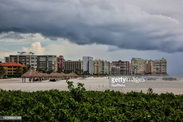 Dark thunderstorm clouds loom over San Marco Beach producing heavy downpours on Marco Island Florida USA on August 29 2018
