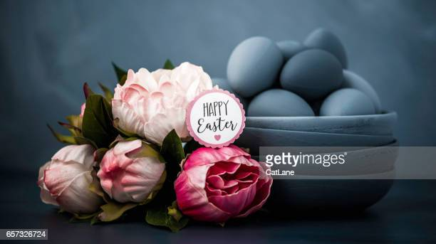 Dark toned Easter still life with peonies and hand painted ombre eggs