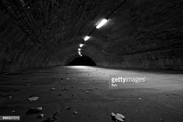 dark tunnel at night (berlin, germany) - verbrechen stock-fotos und bilder