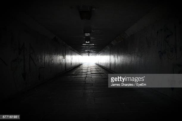 dark tunnel with light at end - light at the end of the tunnel stock pictures, royalty-free photos & images