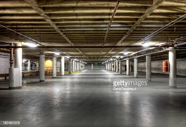 dark underground garage - underground stock photos and pictures