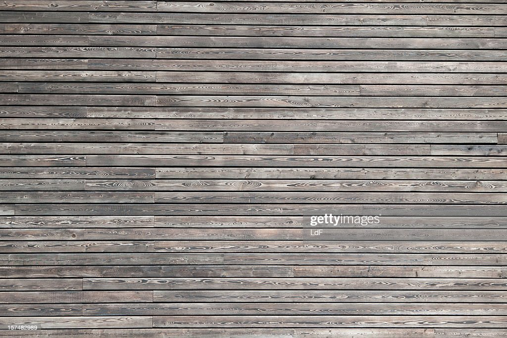 Dark wood cladding of a modern building : Stock Photo