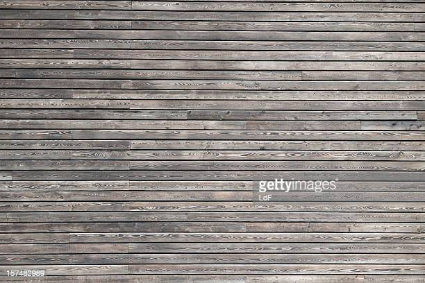 dark wood cladding of a modern building - floorboard stock photos and pictures