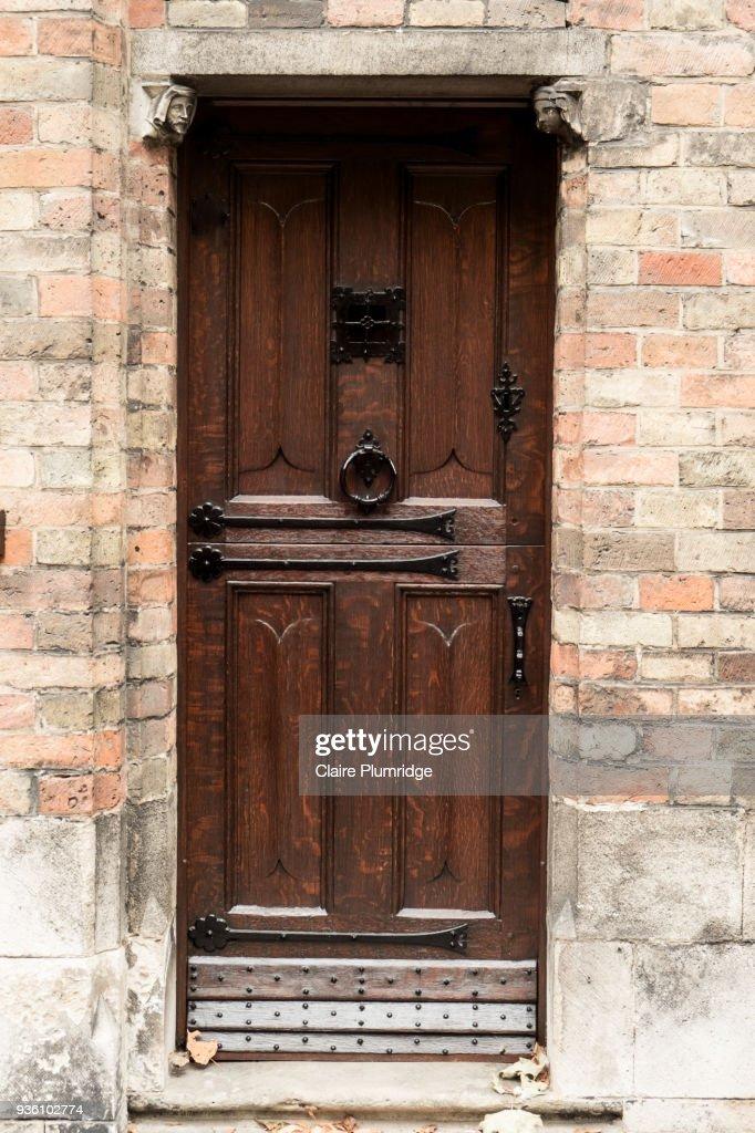 Dark wooden panelled door with  Stock Photo & Dark Wooden Panelled Door With Stock Photo | Getty Images