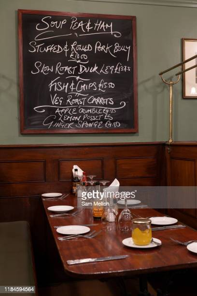 Dark wooden pannelling at the traditional Simpsons Tavern on the 24th September in East London in the United Kingdom The Simpsons Tavern is a...