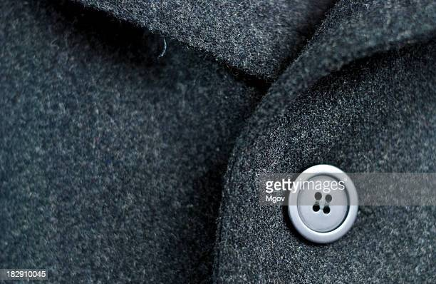 Dark wool coat with one black button