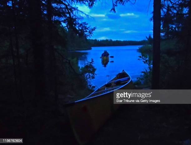 Dark-as-night portage awaits anglers paddling from Swamp Lake in the Boundary Waters Canoe Area Wilderness along the Gunflint Trail.