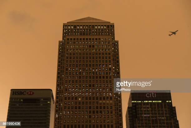 Darkened sky over London is pictured at financial district of Canary Wharf London on October 16 2017 The darkening is caused by warm air and dust...