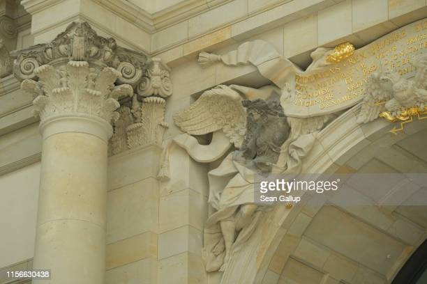 Darker-toned pieces show original, surviving elements in the central entrance hall of the Humboldt Forum stands under construction on June 17, 2019...