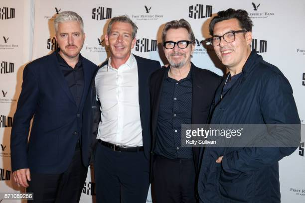 'Darkest Hour' actors Anthony McCarten Ben Mendelsohn Gary Oldman and director Joe Wright pose for photos on the red carpet at the Castro Theatre on...