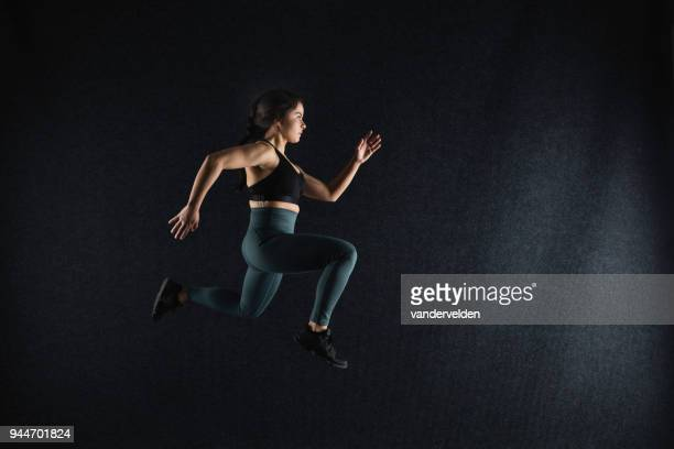 Dark-haired lady running indoors