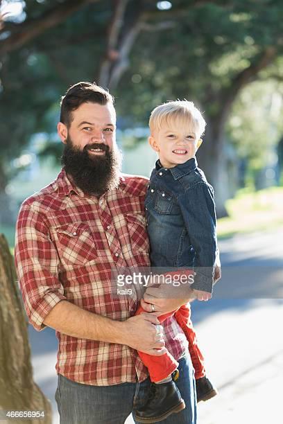 Dark-haired man with blond son