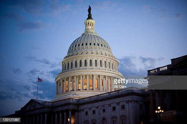 Darkness falls over the Capitol Saturday evening July 30 as Senate leaders on both sides struggle to come to an agreement on the debt ceiling
