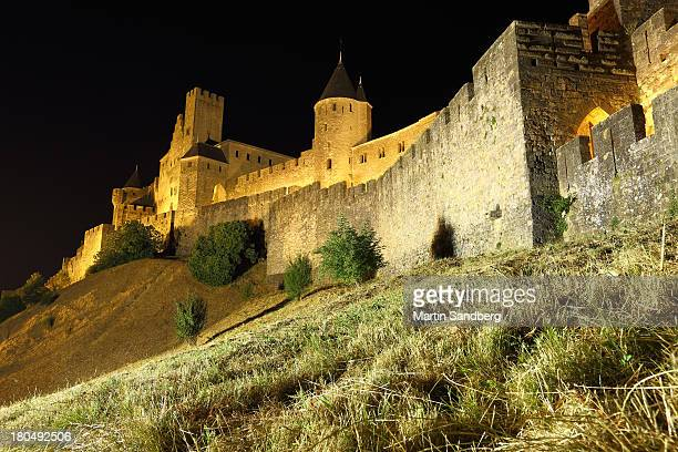 CONTENT] Darkness falls over the medieval city walls and the castle in Carcassonne France Carcassone was founded by the Visigoths in the fifth...