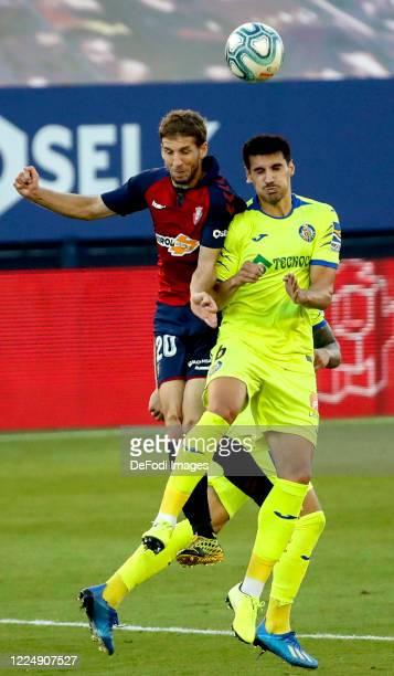 Darko Brasanac of CA Osasuna and Chema Rodriguez of Getafe CF battle for the ball during the Liga match between CA Osasuna and Getafe CF at on July 5...