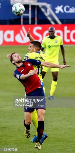 Darko brasanac of CA Osasuna and Mauro Arambarri of Getafe CF battle for the ball during the Liga match between CA Osasuna and Getafe CF at on July 5...