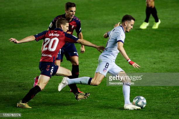 Darko Brasanac of CA Osasuna Inigo Perez of CA Osasuna Saul Niguez of Atletico Madrid during the La Liga Santander match between Osasuna v Atletico...