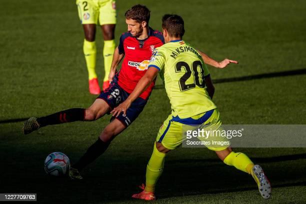 Darko Brasanac of CA Osasuna Maksimovic of Getafe CF during the La Liga Santander match between Osasuna v Getafe at the Estadio El Sadar on July 5...
