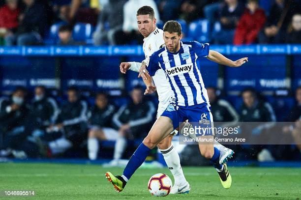 Darko Brasanac of Deportivo Alaves being followed by Sergio Ramos of Real Madrid CF during the La Liga match between Deportivo Alaves and Real Madrid...