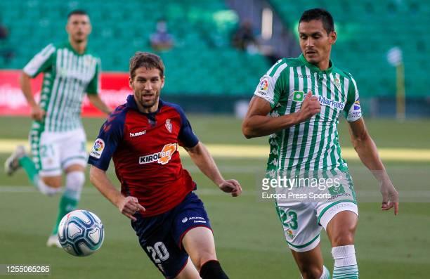 Darko Brasanac of Osasuna and Aissa Mandi of Real Betis in action during the spanish league LaLiga football match played between Real Betis Balompie...