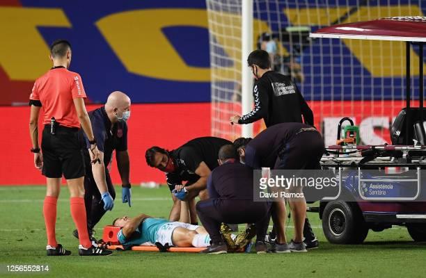 Darko Brasanac of Osasuna is seen injured during the Liga match between FC Barcelona and CA Osasuna at Camp Nou on July 16 2020 in Barcelona Spain