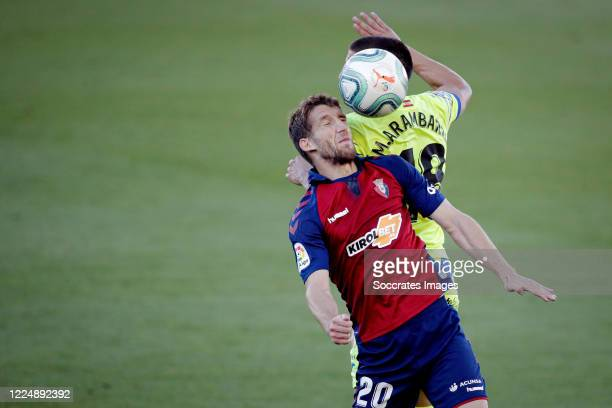 Darko Brasanac of Osasuna Mauro Arambarri of Getafe during the La Liga Santander match between Osasuna v Getafe at the Estadio El Sadar on July 5...