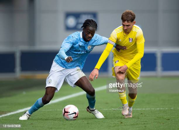 Darko Gyabi of Manchester City and Adrion Pajaziti of Fulham in action during the U18 Premier League match between Manchester City and Fulham at The...