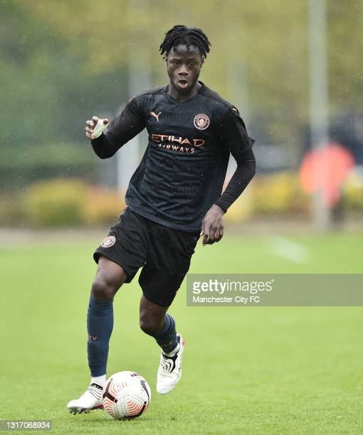 Darko Gyabi of Manchester City runs with the ball during the U18 Premier League match between Stoke City and Manchester City at Clayton Wood Training...