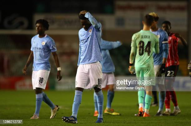 Darko Gyabi of Manchester City U21 looks on, after his team lost on penalties during the EFL Trophy match between Lincoln City and Manchester City...