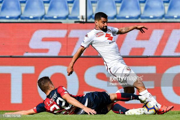 Darko Lazovic of Genoa and Tomas Rincon of Torino vie for the ball during the Serie A match between Genoa CFC and Torino FC at Stadio Luigi Ferraris...