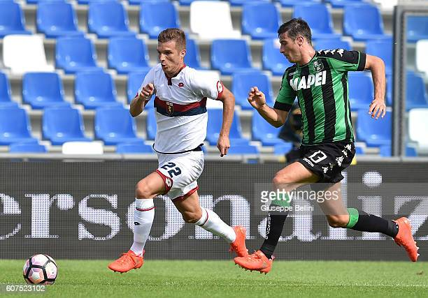 Darko Lazovic of Genoa CFC and Federico Peluso of US Sassuolo in action during the Serie A match between US Sassuolo and Genoa CFC at Mapei Stadium...