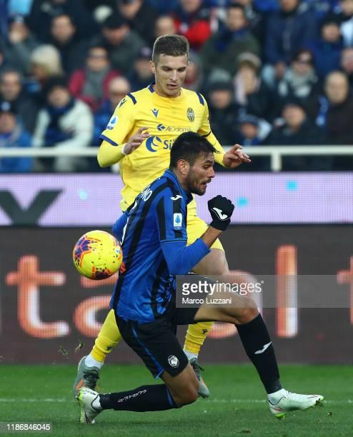Darko Lazovic of Hellas Verona is challenged by Jose Luis Palomino of Atalanta BC during the Serie A match between Atalanta BC and Hellas Verona at...