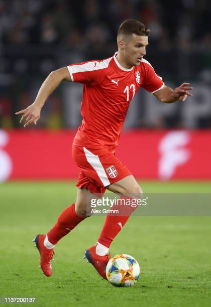 Darko Lazovic of Serbia controls the ball during the International Friendly match between Germany and Serbia at Volkswagen Arena on March 20, 2019 in...