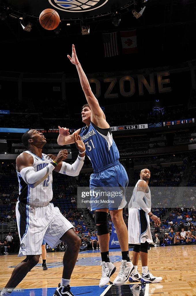 Darko Milicic #31 of the Minnesota Timberwolves shoots against Dwight Howard #12 of the Orlando Magic on November 3, 2010 at the Amway Center in Orlando, Florida.