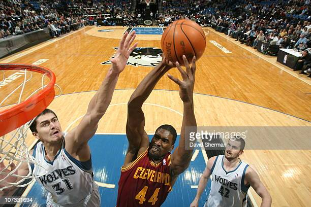 Darko Milicic of the Minnesota Timberwolves tries to block the shot against Leon Powe of the Cleveland Cavaliers during the game on December 4 2010...