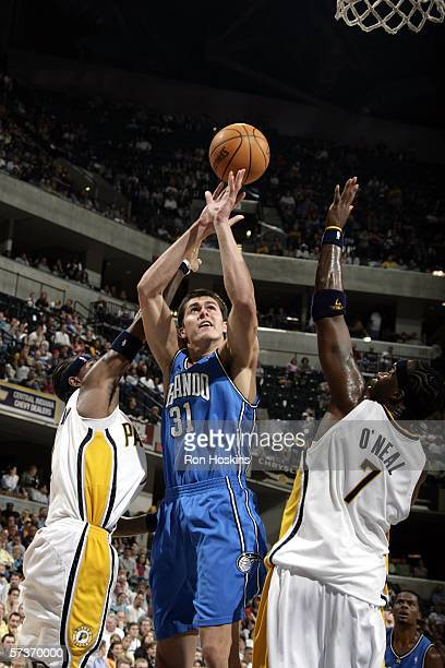 Darko Milicic of the Orlando Magic battles for the ball against Stephen Jackson and Jermaine O'Neal of the Indiana Pacers on April 19, 2006 at...