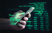 Darkweb, darknet and hacking concept. Hacker with cellphone. Man using dark web with smartphone. Mobile phone fraud, online scam and cyber security threat. Scammer using stolen cell.