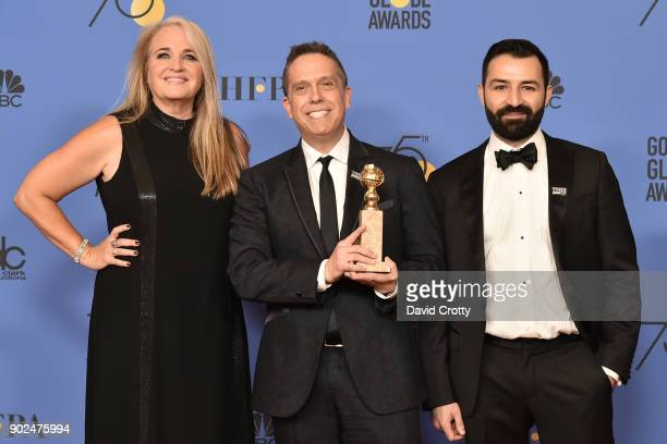Darla K Anderson Lee Unkrich and Adrian Molina attend the 75th Annual Golden Globe Awards Press Room at The Beverly Hilton Hotel on January 7 2018 in...