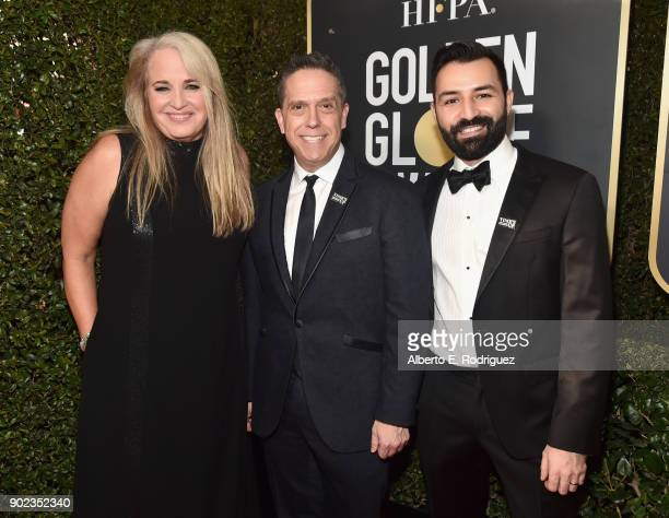 Darla K Anderson Lee Unkrich and Adrian Molina of the film COCO attend The 75th Annual Golden Globe Awards at The Beverly Hilton Hotel on January 7...