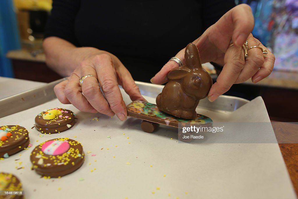 Darlene Eddy handles a skateboarding chocolate Easter bunny in her store Amazing Chocolates on March 28, 2013 in Hollywood, Florida. Americans spend roughly $1.9 billion on Easter candy, second only to Halloween in candy consumption. Around ninety million chocolate Easter bunnies are produced each year, from white to dark chocolate, and with an unlimited varieties of styles.