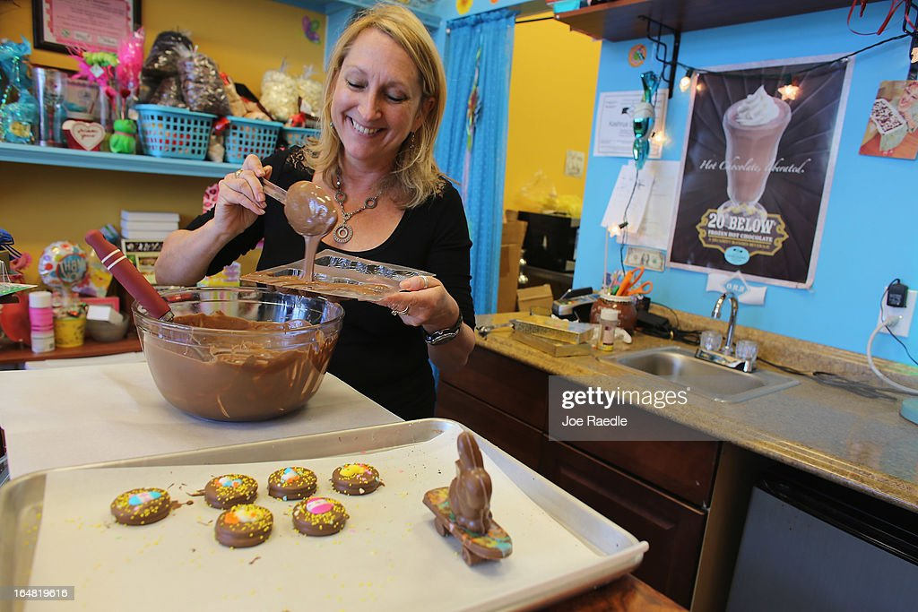 Darlene Eddy pours chocolate into a mold to make a chocolate Easter bunny in her store Amazing Chocolates on March 28, 2013 in Hollywood, Florida. Americans spend roughly $1.9 billion on Easter candy, second only to Halloween in candy consumption. Around ninety million chocolate Easter bunnies are produced each year, from white to dark chocolate, and with an unlimited varieties of styles.