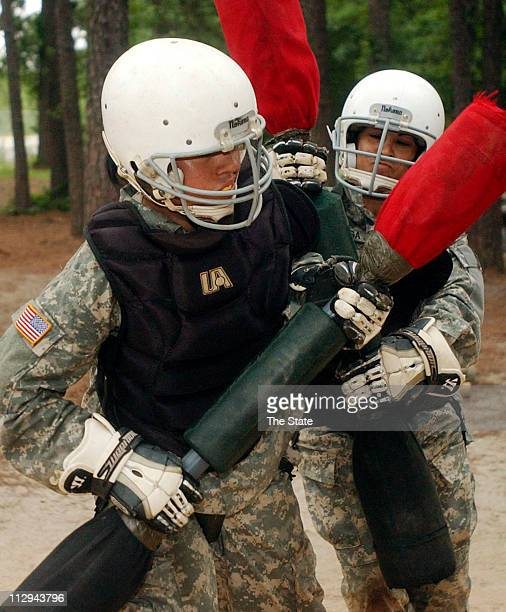 Darlene Lizarraga right and Jessica Avila of El Paso Texas both of Bravo 213 battle in a match of pugil fighting during their first week of Army...