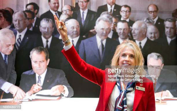 Darlene Sky a docent at The Richard Nixon Presidential Library Museum educates visitors about the major events in the presidency of Richard Nixon in...