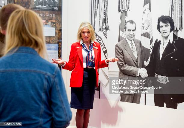 Darlene Sky right a docent at The Richard Nixon Presidential Library Museum tells visitors that the photo of Nixon with Elvis Presley is one of the...