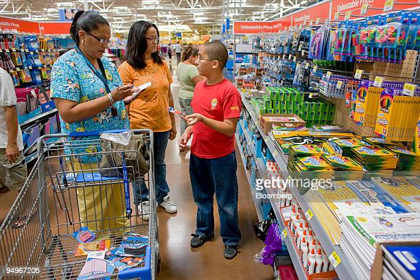 Darlene Soto left shops for school supplies with her children Samantha who is starting 12th grade center and James who is starting 6th grade at a...