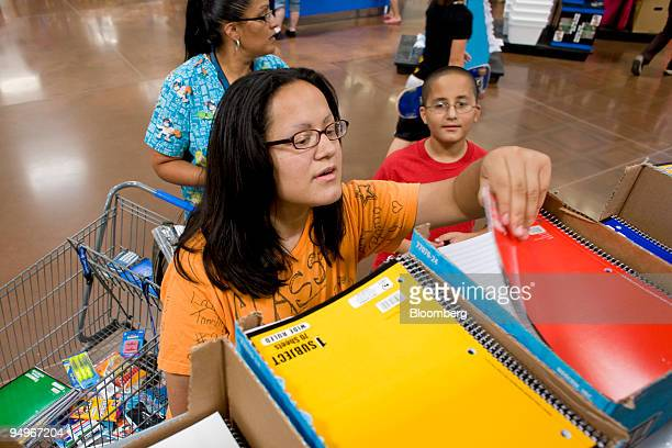 Darlene Soto rear shops for school supplies with her children Samantha who is starting 12th grade left and James who is starting 6th grade at a...