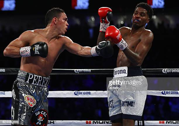 Darleys Perez of Colombia lands a left to the head of opponent Maurice Hooker during their junior welterweights bout at TMobile Arena on November 19...