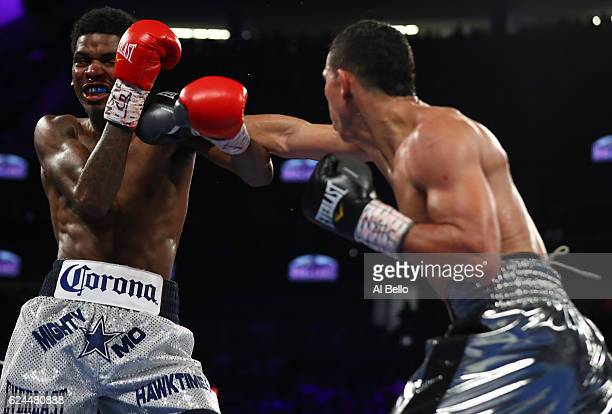 Darleys Perez of Colombia lands a right to the head of opponent Maurice Hooker during their junior welterweights bout at TMobile Arena on November 19...