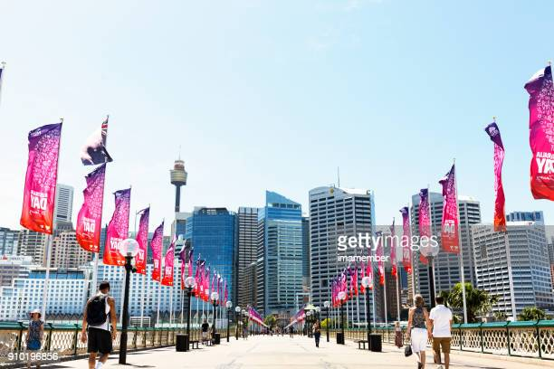 darling harbour pyrmont bridge with australia day colourful flags and city view - darling harbour stock pictures, royalty-free photos & images